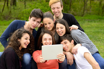 Group of young adults browsing a tablet