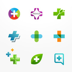 Set of medical logos with cross and plus icons
