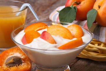 Apricot yoghurt and fresh juice closeup horizontal