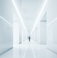 businessman standing in bright office