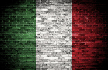 Italian flag on a grunge brick background.