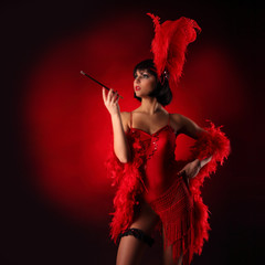 Burlesque dancer with red plumage and short dress, black