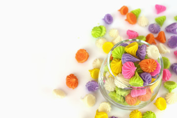 Colorful candy in glass saucer and bowl isolated on white backgr