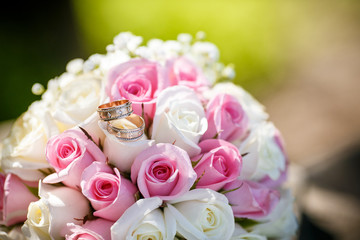 Wedding rings on a roses flowers, focused to the rings