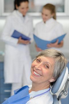 Senior woman patient at dentist surgery smiling