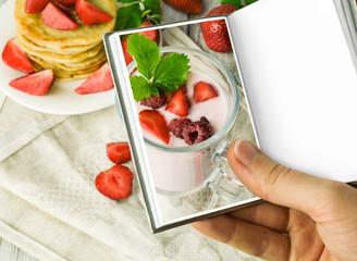 Yogurt and pancakes with strawberries