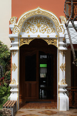 White and gold frame of hotel entrance.