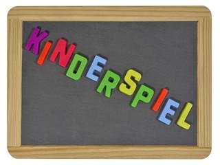 Kinderspiel in colored letters written on traditional slate
