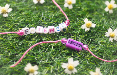two friendship bracelet on grass