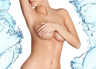 Woman with fresh skin in splashes of water, isolated