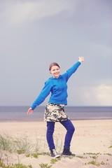 Teen girl having fun on the beach