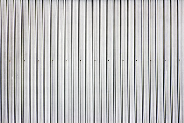 silver corrugated grey aluminium metal wall background for roof top pattern