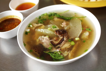 close up chinese chicken soup and vegetable soup in white bowl