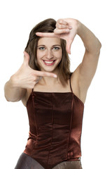 Beautiful woman making frame with her hands