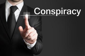 businessman touchscreen conspiracy