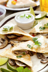 Mexican food. Quesadilla with mushrooms