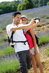 happy young couple making selfie countryside summer trekking