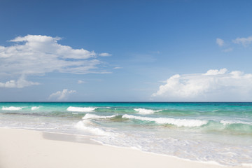 blue sea or ocean, white sand and sky with clouds