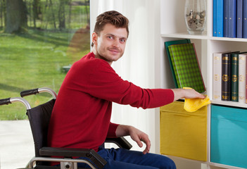 Capable of disabled man wipes the dust