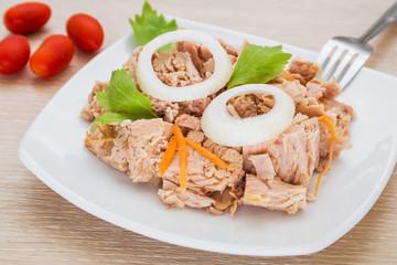 Canned tuna fish on white dish