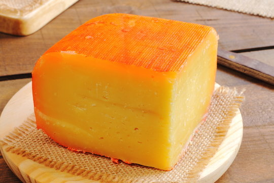Traditional piece of semi matured cheese