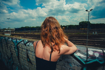 Young woman trainspotting