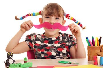 Wall Mural - happy little girl makes paper mustache