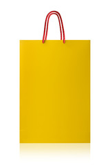 Yellow shopping bag, isolated with clipping path on white backgr