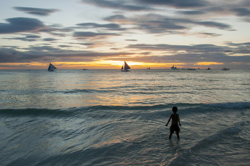 Boy at sunset coast