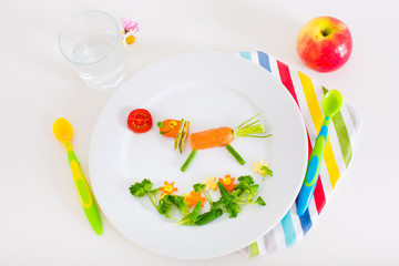 Lunch for kids, fruits and vegetables served as animals