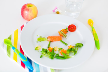 Healthy lunch for kids, fruits and vegetables served as animals
