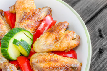 Chicken wings baked with vegetable
