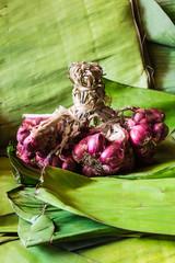 Still life shallots on banana leaves
