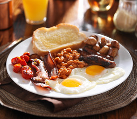 english breakfast with eggs, tomatoes, mushrooms, bacon, beans,