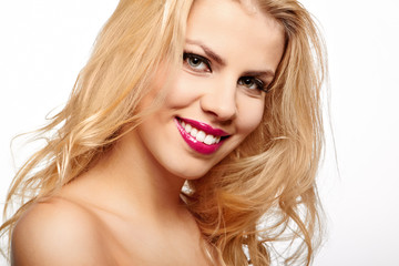 Beautiful young smiling woman with blonde hair