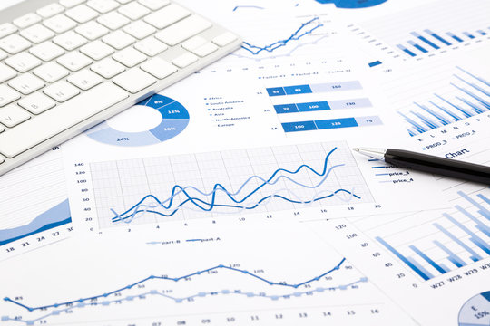 blue graph and chart reports on office table