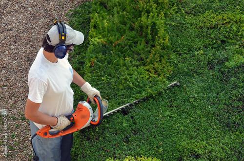 Jardinier photo libre de droits sur la banque d 39 images for Jardinier tarif