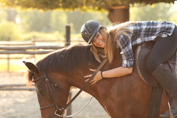 Young woman riding horse Wall mural