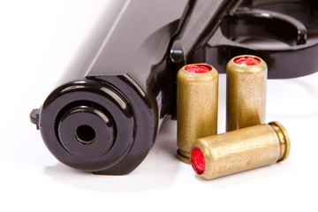Black handgun And ammunition isolated on white