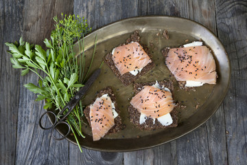starters with salmon butter seeds lemon on rye bread