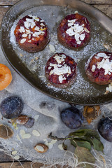 fruits plum cake making with apricots in rustic background