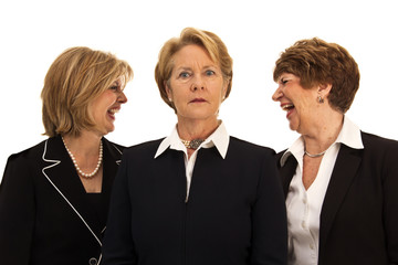 Business Women Laughing Behind Leader's Back