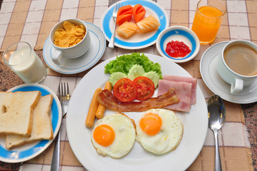 set of american breakfast on table.