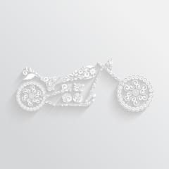 White motorcycle ornament with long shadow