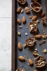 still life composition with cracked walnuts and almonds
