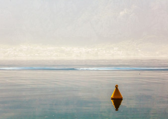 The yellow buoy in the sea