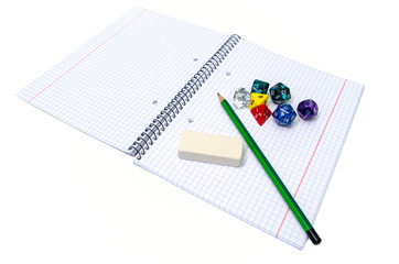 set of exercise book, pencil, rubber and dices isolated on white