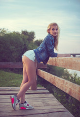 Outdoors portrait of romantic girl with fashion young tall slim