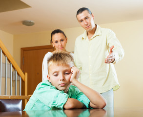Parents scolding teenager son