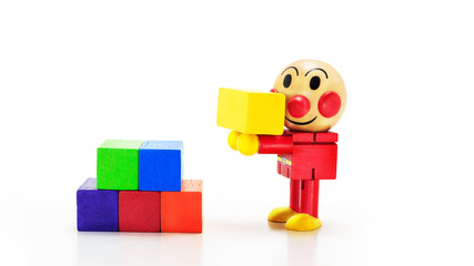 Wooden doll carry a yellow rectangular box